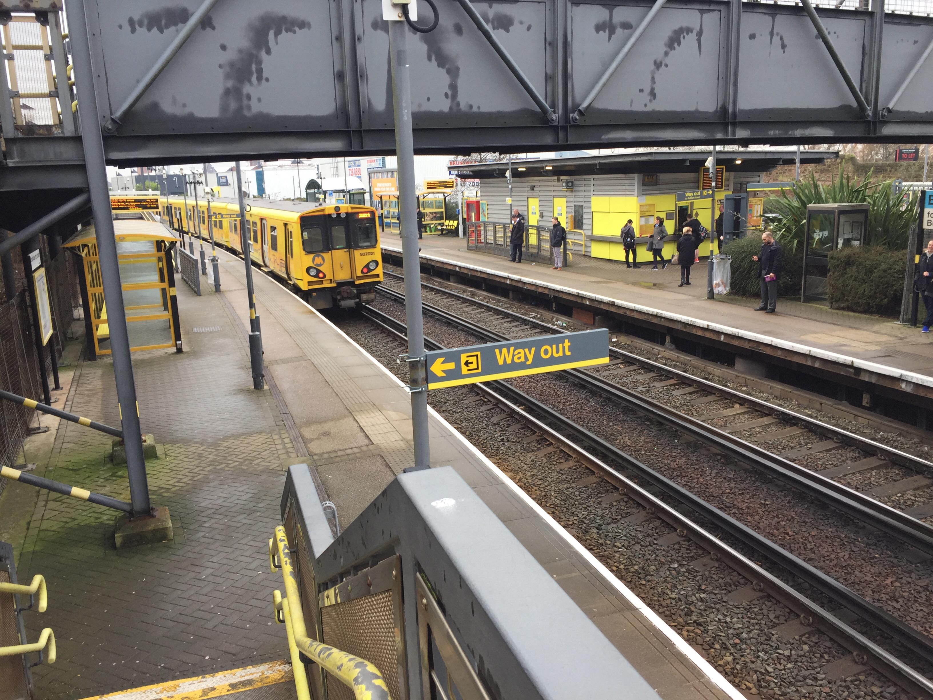 Class 507 departs Brunswick railway station